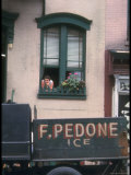 Woman Leaning from Her Window as an Ice Truck Drives by in New York City Premium Photographic Print by Vernon Merritt III