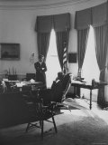 President John F. Kennedy in Office Conferring with Brother Robert about raise in Steel Prices Premium Photographic Print by Art Rickerby