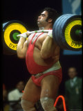 Male Lifting Heavy Weights in Competition at the Olympics Premium fotoprint van John Dominis