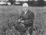 American Poet, Robert Frost Standing in Meadow During Visit to the Gloucester Area of England Premium Photographic Print by Howard Sochurek