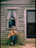 Country Musician, Fred Price, Sitting Outdoors in Front of Old House Playing the Fiddle Premium Photographic Print by Michael Mauney