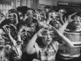Classroom Full of Students Circling Fingers Around Eyes in Form of Glasses During Music Class Premium Photographic Print by Francis Miller
