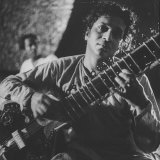 Ravi Shankar Passionately Playing the Sitar Premium Photographic Print by Paul Schutzer