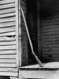 Old Rifle Leaning Up a Wall on the Porch of an Old House Premium Photographic Print by Andreas Feininger