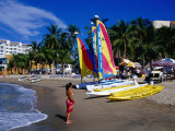 Woman and Yachts on Beach, Westin Regina Resort, Puerto Vallarta, Mexico Photographic Print by Richard Cummins