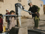 An Elderly Man Pumps Water from a Public Well in Kabul, Afghanistan, Friday, September 22, 2006 Photographic Print by Rodrigo Abd