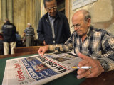 Man with Sports Newspaper, Sorrento, Italy Photographic Print by Holger Leue