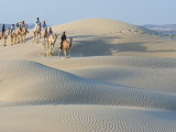 Men Traveling on Camelback Across Sand Dunes, Jaisalmer, Rajasthan, India Photographic Print by Philip Kramer