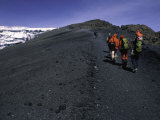 Climbers Heading up a Rocky Trail, Kilimanjaro Photographic Print by Michael Brown
