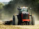 4 Wheel Drive Tractor Pulling a Disc Harrow, Cotswolds, England Photographic Print by Martin Page