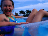 Young Girl Floating in Swimming Pool in Rubber Ring, Gold Coast, Australia Photographic Print by Richard I&#39;Anson
