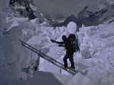 Climbing Across Ladder on Everest, Nepal Photographic Print by Michael Brown