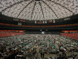 Evacuees from New Orleans Cover the Floor of Houston's Astrodome Saturday Photographic Print