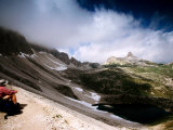 Man Looking Over Boedenknoten Ridge, Sextener Dolomites, Italy Photographic Print by Witold Skrypczak