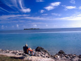 Fisherman in Beach Chair, Florida Keys, Florida, USA Photographic Print by Terry Eggers