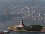 Small Sailing Ships and Pleasure Boats are Moored Near the Statue of Liberty Photographic Print