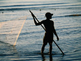 Fisherman Pulling Fishing Net in Sea, Sadani Game Reserve, Tanzania Photographic Print by Ariadne Van Zandbergen