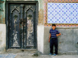 Boy Standing Near Door of Historic House, Baghdad, Iraq Photographic Print by Jane Sweeney