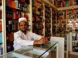 Perfume Shop Owner in Old Souq, Kuwait Photographic Print by Mark Daffey