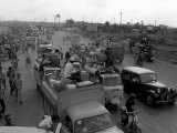 Refugees Fleeing the Advance of Communist Forces Pour into Saigon Photographic Print