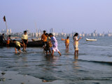 Locals Cooling off in Polluted Waters at Chowpatty Beach, Mumbai, India Fotodruck von Peter Ptschelinzew