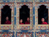 Buddhist Monks Look Through the Windows into the Courtyard of the Tango Monestary Near Thimphu Photographic Print