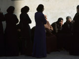 Palestinian Women Sit as They Mourn During the Funeral of Four Al-Aqsa Martyrs' Brigades Militants Photographic Print