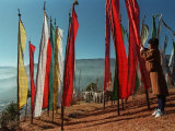 A Bhutanese Man Straightens a Prayer Flag at a Buddhist Shrine Photographic Print