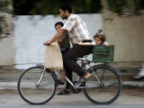 Palestinian Man, 28, Takes His Son, 4, and Daughter, 2, on His Bicycle Photographic Print
