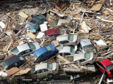 Cars are Piled up Among Debris from Hurricane Katrina Photographic Print