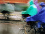 Bike Riders in Storm, Zhenjiang, China Photographic Print by Greg Elms