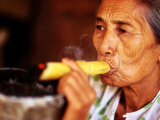 Woman Smokes Handmade Cheroot with Large Ashtray, Bagan, Myanmar (Burma) Lmina fotogrfica por Anthony Plummer