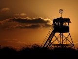 Israeli Soldiers Guard an Observation Tower at Sunset Photographic Print