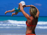 Mother Swinging Baby on Varadero Beach, Varadero, Cuba Fotografie-Druck von Philip Smith