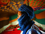 A Man, Wearing his Traditional Tuareg Turban, Stands in His Tent in Koygma Photographic Print