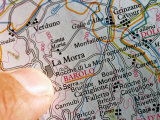Finger on Map of Italy Pointing to Barolo, Near Alba, Italy Photographic Print by Oliver Strewe
