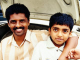 Portrait of Father and Son on Car at Devaraja Market, Mysore, India Lmina fotogrfica por Michael Taylor