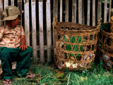 Tired Boy with Baskets, Inle Lake, Myanmar (Burma) Fotografisk tryk af Anthony Plummer
