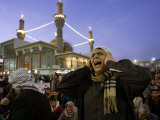 A Shiite Muslim Worshipper Sings the Call for Prayer at the Kadhimiya Shrine Photographic Print