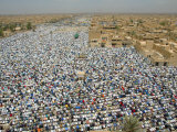 Thousands Kneel for Prayers Photographic Print
