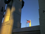 The World War II Memorial, a U.S. Flag and the Washington Monument Photographic Print by Raul Touzon