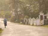 Woman Walking in Sea Mist, Bathsheba, Barbados Photographic Print by Walter Bibikow
