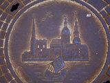 Latvia, Riga, Manhole Cover in Street, Close-up Photographic Print by  Keenpress