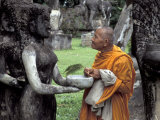 Old Monk Praying at Xieng Khuan (Buddha Park), Laos Photographic Print by Keren Su