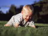 A Baby Boy Crawls Through the Green Grass Photographic Print by Joel Sartore