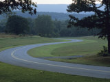 View of a Curve in a Road at Fort Frederick State Park Photographic Print by Raymond Gehman