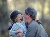 A Father and His Daughter Laugh Together While Wearing Coonskin Hats Photographic Print by Joel Sartore