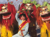 Girl Playing Lion Dance for Chinese New Year, Beijing, China Photographic Print by Keren Su