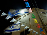 Light Shinning Through the Flag of Israel, Low Angle View Photographic Print by  Keenpress