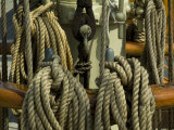 Coiled Ropes Hanging on an Old Wooden Ship Photographic Print by Todd Gipstein